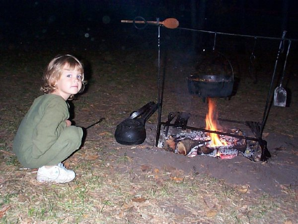 child and cooking fire